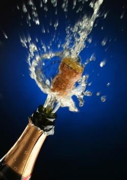 Champagne splash. Bottle and cork, celebration time